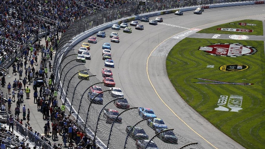 Cars line up after a yellow during the Sprint Cup auto race at Richmond International Raceway in Richmond, Va., Sunday, April 24, 2016. (AP Photo/Chet Strange)