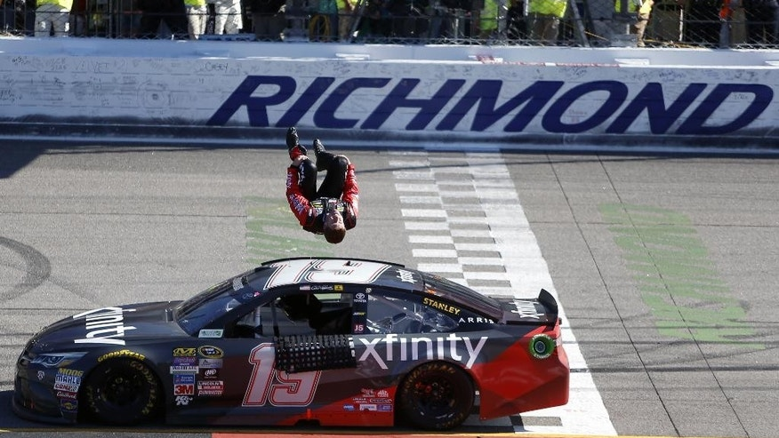 Carl Edwards does a back flip off his car after winning the Sprint Cup auto race at Richmond International Raceway in Richmond, Va., Sunday, April 24, 2016. (AP Photo/Chet Strange)