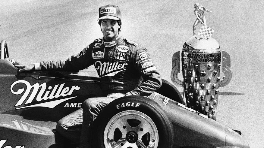 FILE - In this May 27, 1985 file photo, Danny Sullivan sits on his championship race car for the traditional photographs of the Indianapolis 500 winner on the finish line at Indianapolis Motor Speedway in Indianapolis, Ind. (AP Photo/Michael Conroy, File)