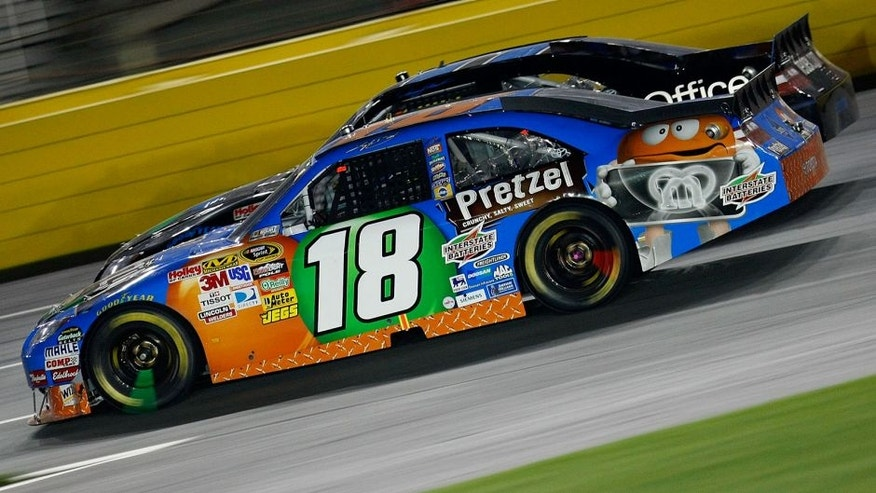 CONCORD, NC - MAY 22: Kyle Busch, driver of the #18 M&M's Pretzel Toyota, races Denny Hamlin, driver of the #11 FedEx Office Toyota, during the NASCAR Sprint All-Star Race at Charlotte Motor Speedway on May 22, 2010 in Concord, North Carolina. (Photo by Geoff Burke/Getty Images for NASCAR) *** Local Caption *** Kyle Busch;Denny Hamlin