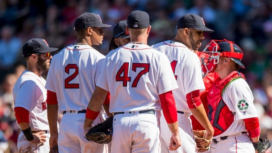 BOSTON, MA - APRIL 21: David Price #24 of the Boston Red Sox reacts during a mound visit during the fourth inning of a game against the Tampa Bay Rays on April 21, 2016 at Fenway Park in Boston, Massachusetts . (Photo by Billie Weiss/Boston Red Sox/Getty Images) *** Local Caption *** David Price