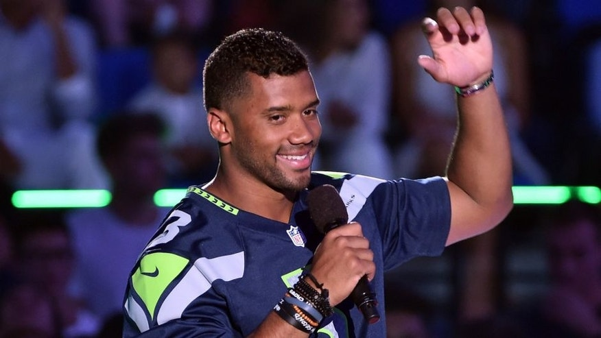 WESTWOOD, CA - JULY 16: Host Russell Wilson speaks onstage at the Nickelodeon Kids' Choice Sports Awards 2015 at UCLA's Pauley Pavilion on July 16, 2015 in Westwood, California. (Photo by Kevin Winter/Getty Images)