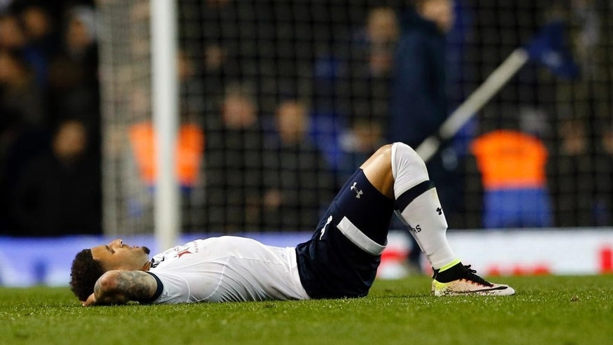 Tottenham Hotspur's Kyle Walker lies flat out on the pitch at the end of their English Premier League soccer match between Tottenham Hotspur and West Bromwich Albion at White Hart Lane in London, Monday, April 25,  2016. (AP Photo/Alastair Grant)