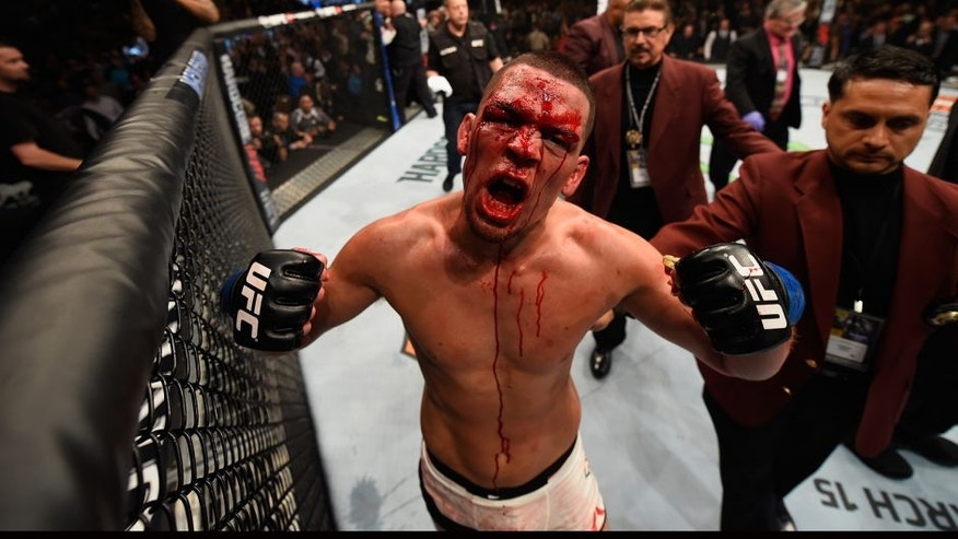 LAS VEGAS, NV - MARCH 05: Nate Diaz reacts to his victory over Conor McGregor of Ireland in their welterweight bout during the UFC 196 event inside MGM Grand Garden Arena on March 5, 2016 in Las Vegas, Nevada. (Photo by Josh Hedges/Zuffa LLC/Zuffa LLC via Getty Images)