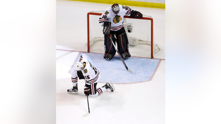 Chicago Blackhawks goalie Corey Crawford, top, and teammate Artem Anisimov, of Russia, pause after allowing a goal by St. Louis Blues' Troy Brouwer during the third period in Game 7 of an NHL hockey first-round Stanley Cup playoff series Monday, April 25, 2016, in St. Louis. The Blues won 4-3 to take the series 4-3. (AP Photo/Jeff Roberson)