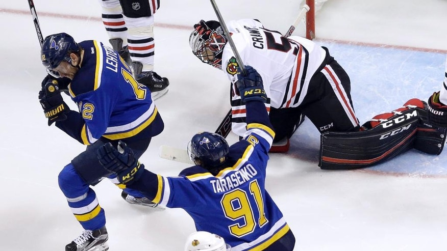 St. Louis Blues' Jori Lehtera, left, of Finland, celebrates along side teammate Vladimir Tarasenko (91), of Russia, after scoring bast Chicago Blackhawks goalie Corey Crawford, right, during the first period in Game 7 of an NHL hockey first-round Stanley Cup playoff series Monday, April 25, 2016, in St. Louis. The Blues won 4-3 to take the series 4-3. (AP Photo/Jeff Roberson)