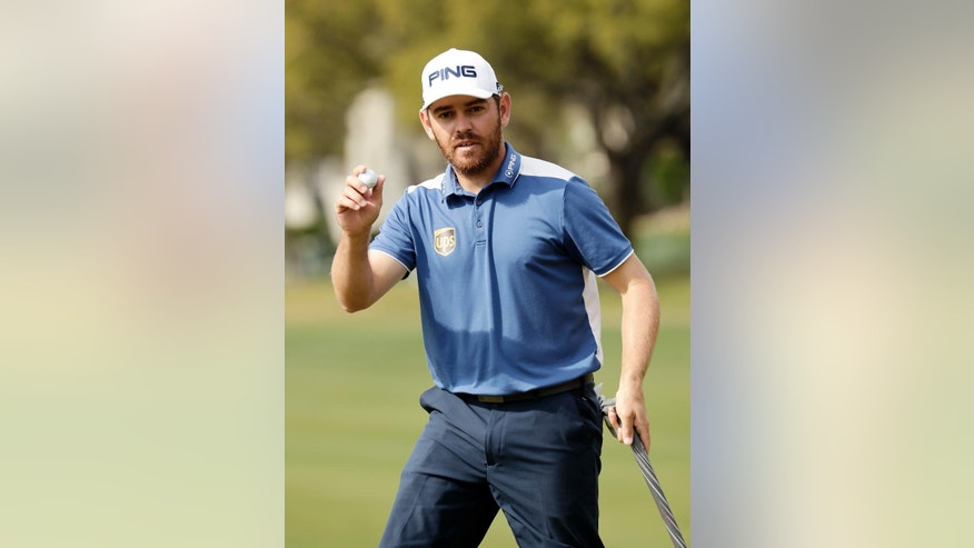 FILE - In this March 27,2016, file photo, Louis Oosthuizen, of South Africa, acknowledges the crowd after sinking a putt on the fifth green during semifinal round play against Rafa Cabrera Bello of Spain at the Dell Match Play Championship golf tournament at Austin County Club in Austin, Texas. Oosthuizen said Thursday, April 21, 2016, that he won't be taking part in golf's return to the Olympics this year, the third major champion to withdraw in the last week as the deadline nears to confirm participation. (AP Photo/Charlie Riedel, File)