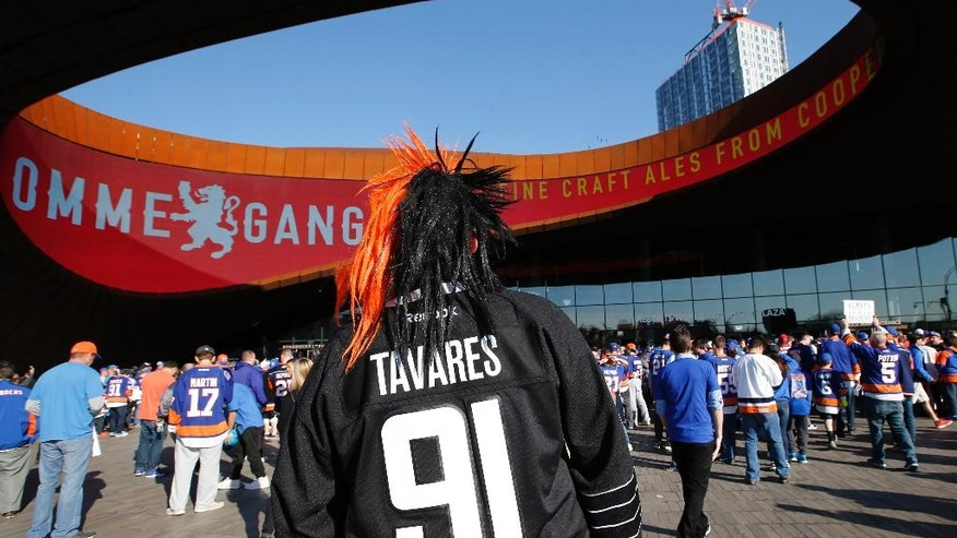 New York Islanders fan Adam DeMaio wears a New York Islanders center John Tavares jersey (91) before Game 6 of an NHL hockey first-round Stanley Cup playoff series between the New York Islanders and the Florida Panthers in New York, Sunday, April 24, 2016. (AP Photo/Kathy Willens)