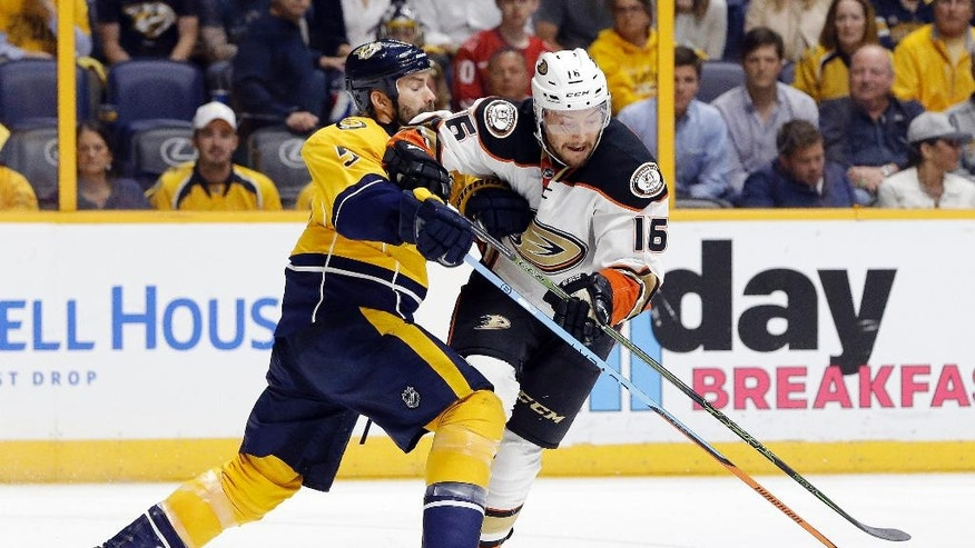 Anaheim Ducks center Ryan Garbutt (16) battles Nashville Predators defenseman Barret Jackman (5) for the puck in the third period of Game 6 in an NHL hockey first-round Stanley Cup playoff series Monday, April 25, 2016, in Nashville, Tenn. The Predators won 3-1 to even the series 3-3. (AP Photo/Mark Humphrey)