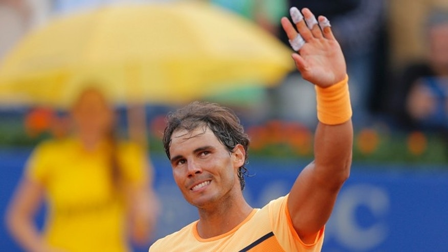 Rafael Nadal celebrates his victory over Philipp Kohlschreiber Saturday, April 23, 2016.