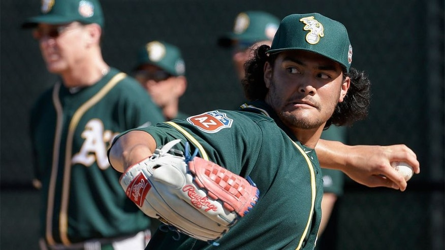 Oakland Athletics pitcher Sean Manaea throws during spring training baseball practice in Mesa, Ariz., Sunday, Feb. 21, 2016. (AP Photo/Chris Carlson)