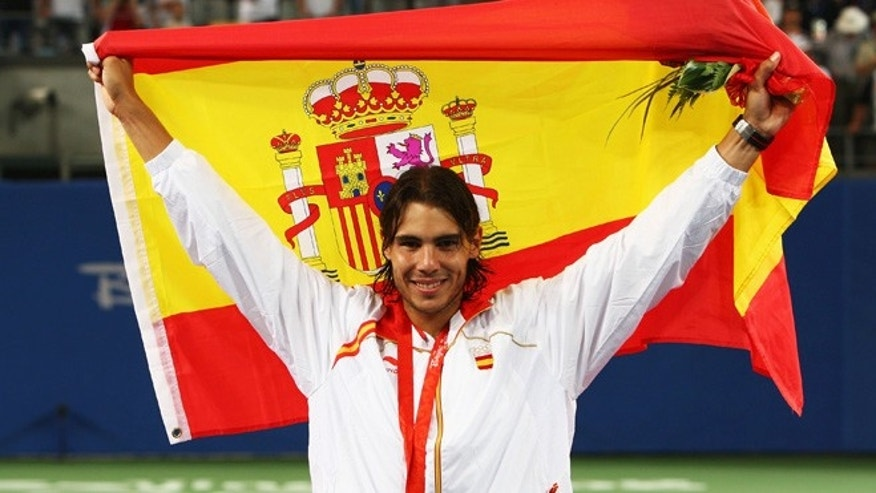 BEIJING - AUGUST 17:  Rafael Nadal of Spain celebrates winning the gold medal against Fernando Gonzalez of Chile during the men's singles gold medal tennis match held at the Olympic Green Tennis Center during Day 9 of the Beijing 2008 Olympic Games on August 17, 2008 in Beijing, China.  (Photo by Clive Brunskill/Getty Images)