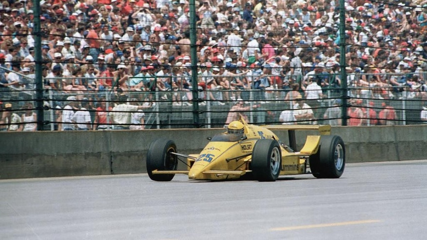 FILE - In this May 24, 1987 file photo, Al Unser, driving a Penske March-Cosworth, heads down the main straightaway during the 71st running of the Indianapolis 500 auto race at Indianapolis Motor Speedway in Indianapolis, Ind. (AP Photo/Mark Duncan, File)