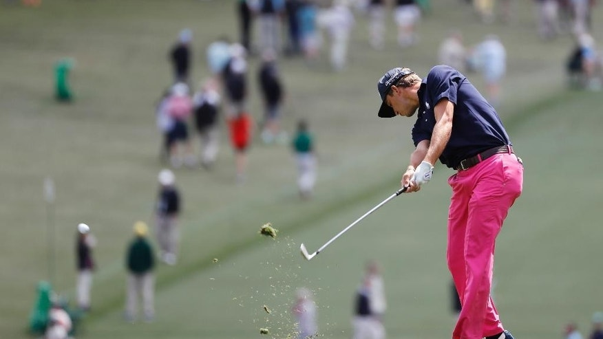 """FILE - In this April 7, 2016, file photo, Smylie Kaufman hits on the first fairway during the first round of the Masters golf tournament in Augusta, Ga. Fresh off his impressive showing at the Masters, PGA Tour rookie and former LSU golfer Kaufman is preparing for another heaping of fanfare at the Zurich Classic. """"This is definitely a home game for me,"""" Kaufman said. In terms of fan support, that is. As far as knowing the ins and outs of the Pete Dye-designed TPC Louisiana course, not so much. (AP Photo/Matt Slocum, File)"""