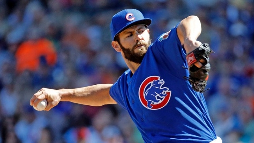FILE - In this March 9, 2016 file photo, Chicago Cubs pitcher Jake Arrieta, last season's National League Cy Young winner, throws during a spring training baseball game against the Cleveland Indians in Mesa, Ariz. The Cubs open their regular season against the Los Angeles Angels on Monday night April 4, 2016, in Anaheim. (AP Photo/Morry Gash, File)