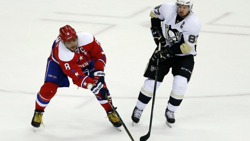 FILE - In this April 7, 2016 file photo, Washington Capitals left wing Alex Ovechkin (8), from Russia, loses the puck as Pittsburgh Penguins center Sidney Crosby (87) pursues in the third period of an NHL hockey game, in Washington. Sidney Crosby vs. Alex Ovechkin, Alex Ovechkin vs. Sidney Crosby. But the second-round playoff series between the Penguins and Capitals goes beyond the two NHL superstars. (AP Photo/Alex Brandon, File)