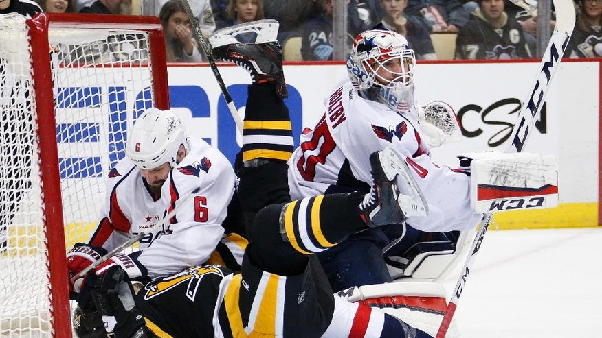 FILE - In this March 20, 2016 file photo, Washington Capitals' Mike Weber (6) and Pittsburgh Penguins' Bryan Rust (17) collide in the goal cage behind Capitals goalie Braden Holtby (70) during the second period of an NHL hockey game in Pittsburgh. Sidney Crosby vs. Alex Ovechkin, Alex Ovechkin vs. Sidney Crosby. But the second-round playoff series between the Penguins and Capitals goes beyond the two NHL superstars.  (AP Photo/Gene J. Puskar, File)