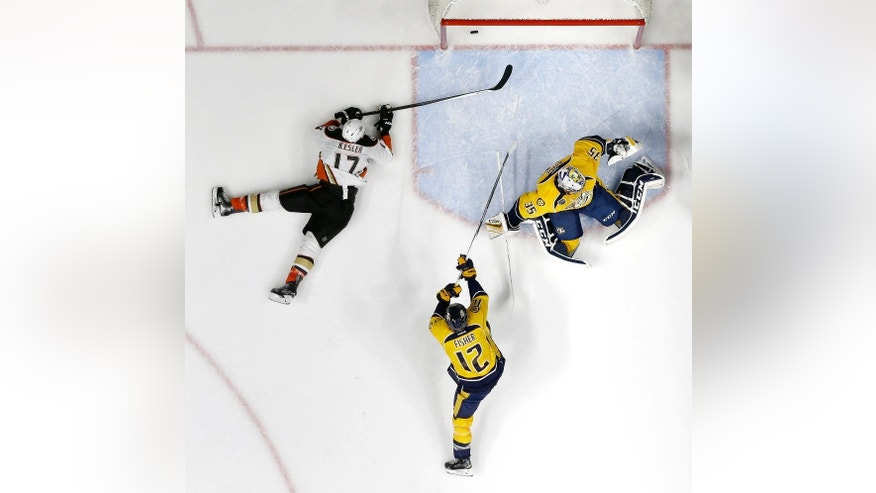 Anaheim Ducks center Ryan Kesler (17) scores a goal against Nashville Predators goalie Pekka Rinne (35), of Finland, and forward Mike Fisher (12) in the second period of Game 6 in an NHL hockey first-round Stanley Cup playoff series Monday, April 25, 2016, in Nashville, Tenn. The Predators won 3-1 to even the series 3-3. (AP Photo/Mark Humphrey)