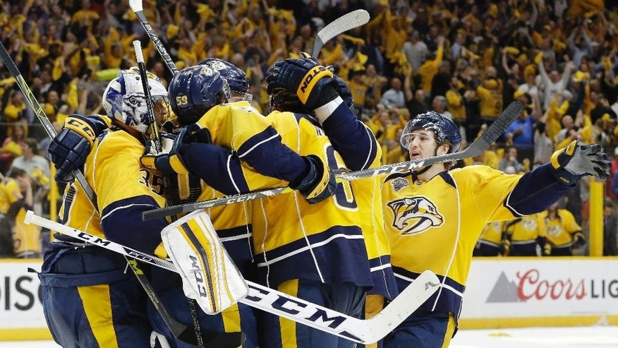 Nashville Predators center Filip Forsberg, of Sweden, right, joins the celebration after defenseman Shea Weber (6) scored an empty-net goal against the Anaheim Ducks in the final seconds of the third period to give the Predators a 3-1 win in Game 6 of an NHL hockey first-round Stanley Cup playoff series Monday, April 25, 2016, in Nashville, Tenn. The Predators evened the series 3-3. (AP Photo/Mark Humphrey)