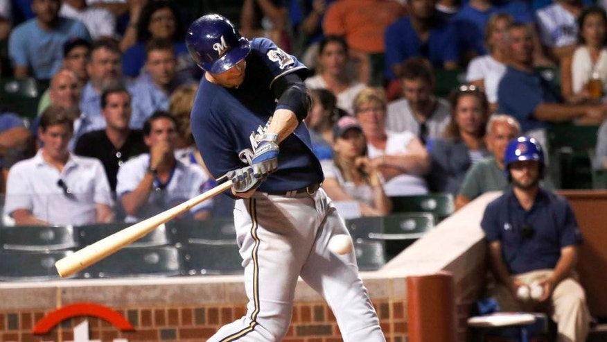 Tuesday, September 2: The Milwaukee Brewers' Ryan Braun hits a RBI single off Chicago Cubs starting pitcher Jake Arrieta during the third inning.