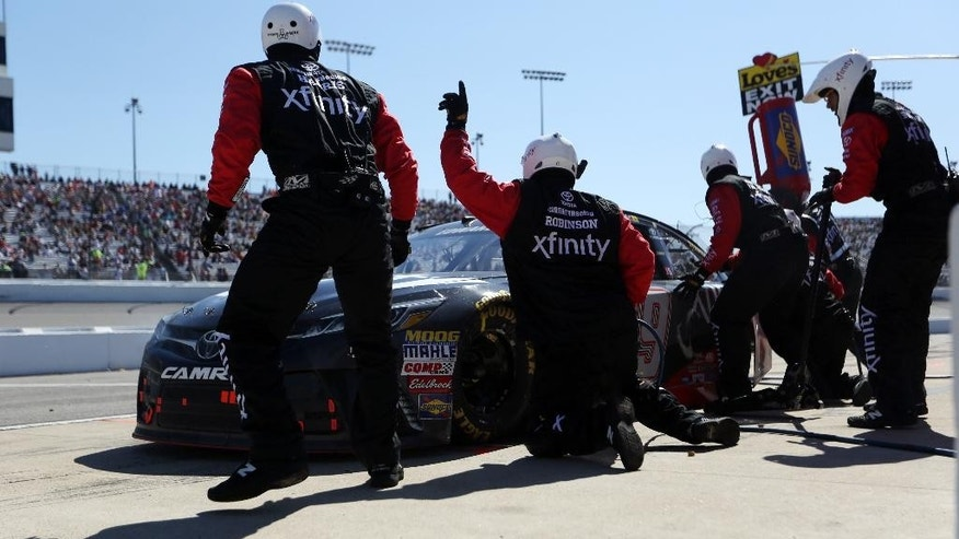 Carl Edwards comes in for a pit stop during the Sprint Cup auto race at Richmond International Raceway in Richmond, Va., Sunday, April 24, 2016. (AP Photo/Chet Strange)