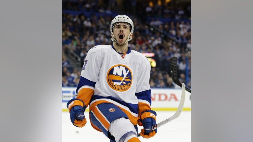 New York Islanders' Shane Prince (11) celebrates his first goal during the first period of Game 1 of the NHL hockey Stanley Cup Eastern Conference semifinals against the Tampa Bay Lightning, Wednesday, April 27, 2016, in Tampa, Fla. (AP Photo/Chris O'Meara)