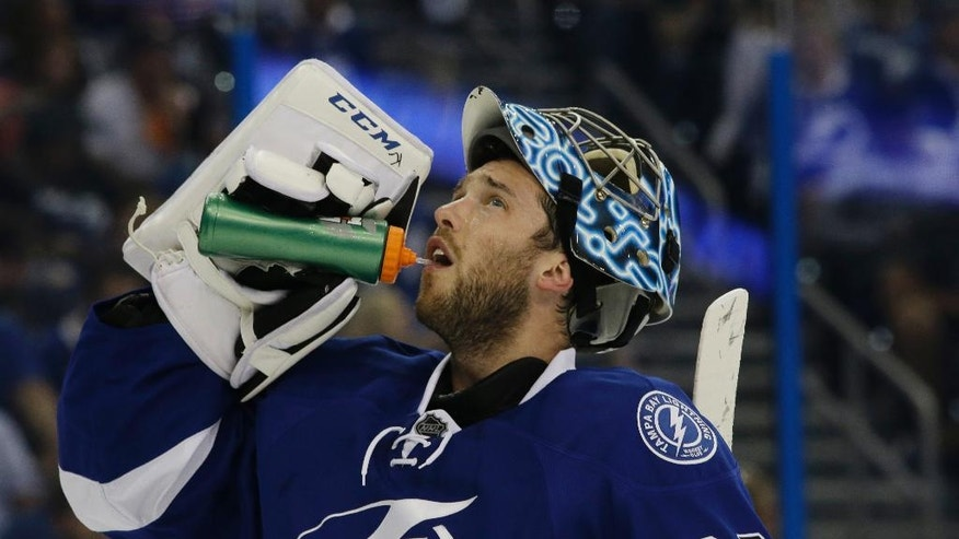 Tampa Bay Lightning goalie Ben Bishop takes a break during the first period of Game 1 of the team's NHL hockey Stanley Cup Eastern Conference semifinals against the New York Islanders, Wednesday, April 27, 2016, in Tampa, Fla. (AP Photo/Chris O'Meara)