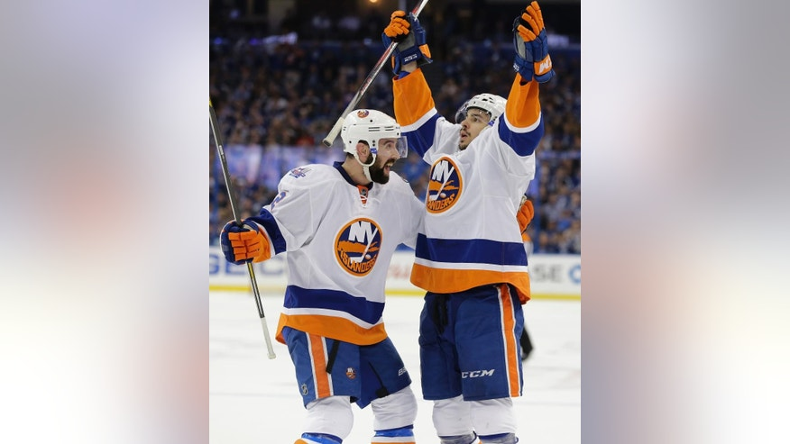 New York Islanders' Shane Prince, right, is congratulates by Nick Leddy after Prince scored his second goal during the first period of Game 1 of the NHL hockey Stanley Cup Eastern Conference semifinals against the Tampa Bay Lightning, Wednesday, April 27, 2016, in Tampa, Fla. (AP Photo/Chris O'Meara)