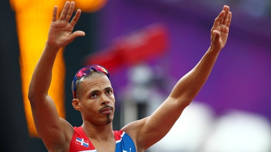 LONDON, ENGLAND - AUGUST 04: Felix Sanchez of Dominican Republic celebrates after competing in the Men's 400m Hurdles Semi Final on Day 8 of the London 2012 Olympic Games at Olympic Stadium on August 4, 2012 in London, England.  (Photo by Michael Steele/Getty Images)