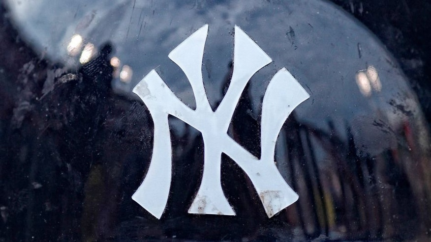 CINCINNATI, OH - JUNE 22: Detail view of the New York Yankees logo on the front of a batting helmet before the game against the Cincinnati Reds at Great American Ball Park on June 22, 2011 in Cincinnati, Ohio. The Reds won 10-2. (Photo by Joe Robbins/Getty Images)