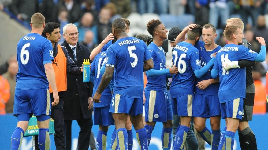 Leicester's manager Claudio Ranieri, 3rd left, celebrates with players at the end of the English Premier League soccer match between Leicester City and Swansea City at the King Power Stadium in Leicester, England, Sunday, April 24, 2016. (AP Photo/Rui Vieira)