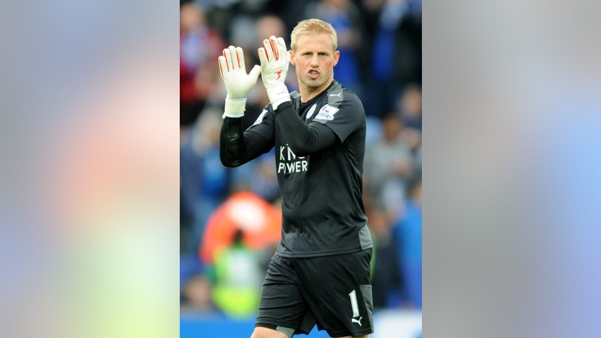 Leicester's Kasper Schmeichel applauds to fans at the end of the English Premier League soccer match between Leicester City and Swansea City at the King Power Stadium in Leicester, England, Sunday, April 24, 2016. (AP Photo/Rui Vieira)