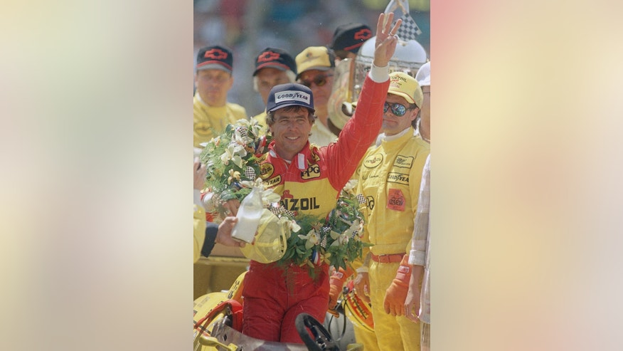 FILE - In this May 29, 1988 file photo, Rick Mears holds up three fingers after winning his third Indianapolis 500 auto race after the 72nd running of the race in Indianapolis, Ind. (AP Photo/Mary Ann Carter, File)