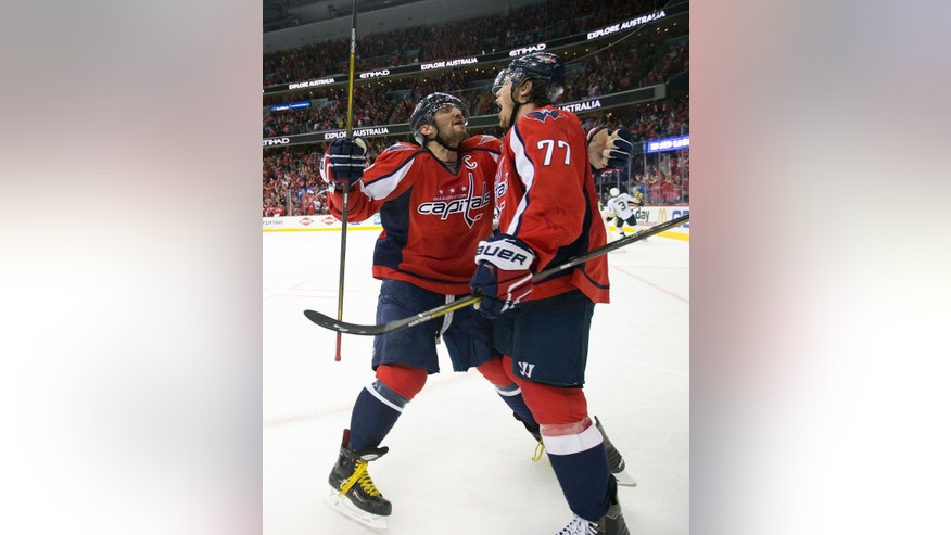 Washington Capitals right wing T.J. Oshie celebrates his goal with teammate Alex Ovechkin (8) against the Pittsburgh Penguins during the second period of Game 1 in an NHL hockey Stanley Cup Eastern Conference semifinals Thursday, April 28, 2016 in Washington. (AP Photo/Pablo Martinez Monsivais)