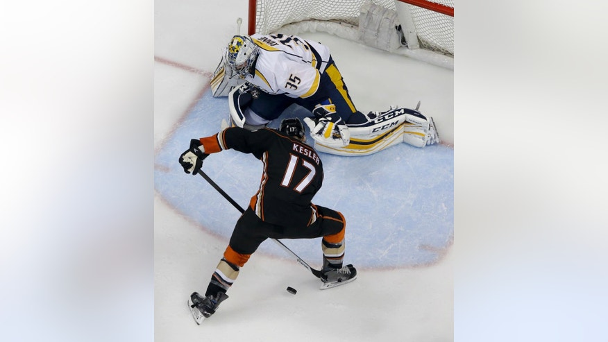 Nashville Predators goalie Pekka Rinne, top, blocks a shot by Anaheim Ducks center Ryan Kesler during the second period of Game 7 in an NHL hockey Stanley Cup playoffs first-round series in Anaheim, Calif., Wednesday, April 27, 2016. (AP Photo/Chris Carlson)