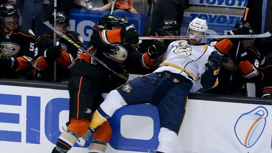 Anaheim Ducks defenseman Clayton Stoner, left, checks Nashville Predators center Paul Gaustad during the first period of Game 7 in an NHL hockey Stanley Cup playoffs first-round series in Anaheim, Calif., Wednesday, April 27, 2016. (AP Photo/Chris Carlson)
