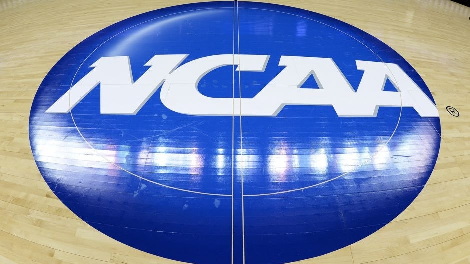 CHARLOTTE, NC - MARCH 22: A view of the NCAA logo at mid-court prior to a game between the Michigan State Spartans and the Virginia Cavaliers during the third round of the 2015 NCAA Men's Basketball Tournament at Time Warner Cable Arena on March 22, 2015 in Charlotte, North Carolina. Michigan State won 60-54. (Photo by Lance King/Getty Images)