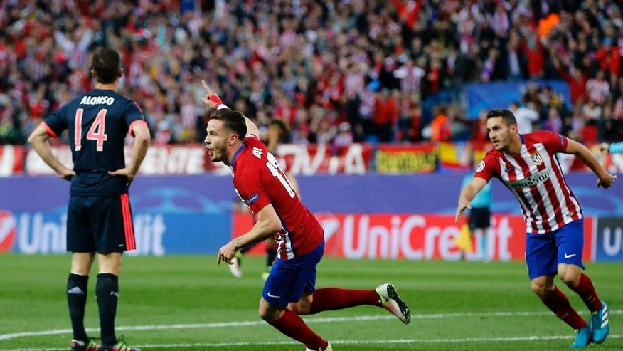 Atletico's Saul celebrates after scoring his side's opening goal during the Champions League 1st leg semifinal soccer match between Atletico Madrid and Bayern Munich at the Vicente Calderon stadium in Madrid, Spain, Wednesday, April 27, 2016. (AP Photo/Paul White)