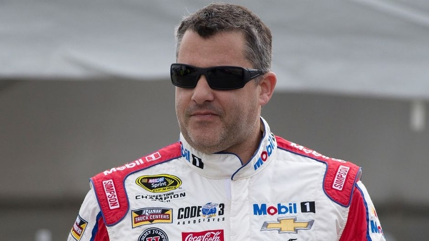 RICHMOND, VA - APRIL 22: Tony Stewart, driver of the #14 Mobil 1 Advanced Fuel Economy Chevrolet, stands in the garage area during practice for the NASCAR Sprint Cup Series TOYOTA OWNERS 400 at Richmond International Raceway on April 22, 2016 in Richmond, Virginia. (Photo by Daniel Shirey/NASCAR via Getty Images)