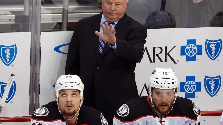 FILE - In this Feb. 8, 2016 file photo, Anaheim Ducks head coach Bruce Boudreau stands behind his bench during an NHL hockey game against the Pittsburgh Penguins in Pittsburgh. The Anaheim Ducks have fired coach Bruce Boudreau after their first-round exit from the playoffs. Ducks general manager Bob Murray announced the decision Friday, April 29, 2016. (AP Photo/Gene J. Puskar, File)