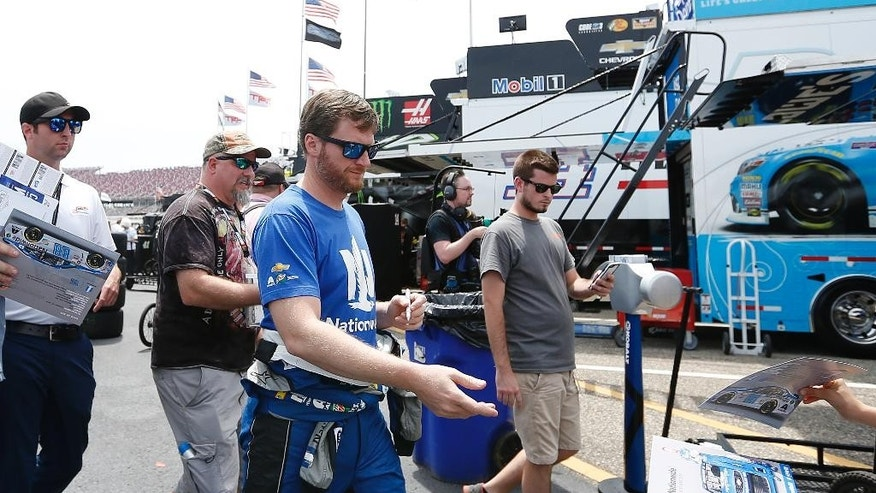 NASCAR driver Dale Earnhardt Jr., signs autographs before practice for Sunday's NASCAR auto race at Talladega Superspeedway, Friday, April 29, 2016, in Talladega, Ala. (AP Photo/Brynn Anderson)