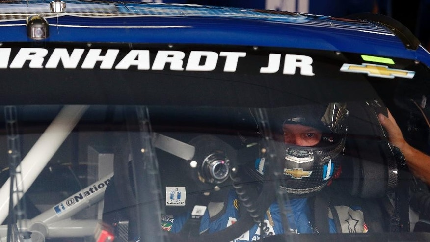 NASCAR driver Dale Earnhardt Jr., sits in his car as he gets ready to practice for Sunday's NASCAR auto race at Talladega Superspeedway, Friday, April 29, 2016, in Talladega, Ala. (AP Photo/Brynn Anderson)