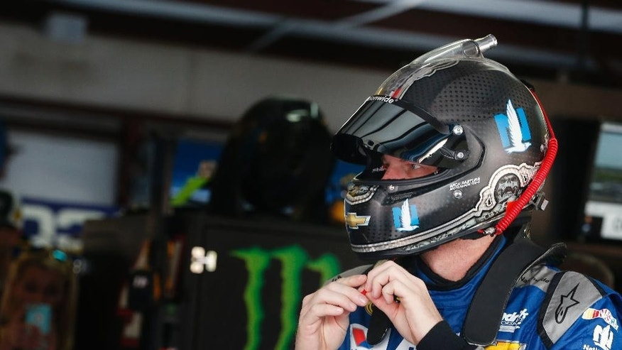 NASCAR driver Dale Earnhardt Jr. gets ready to practice for Sunday's NASCAR auto race at Talladega Superspeedway, Friday, April 29, 2016, in Talladega, Ala. (AP Photo/Brynn Anderson)