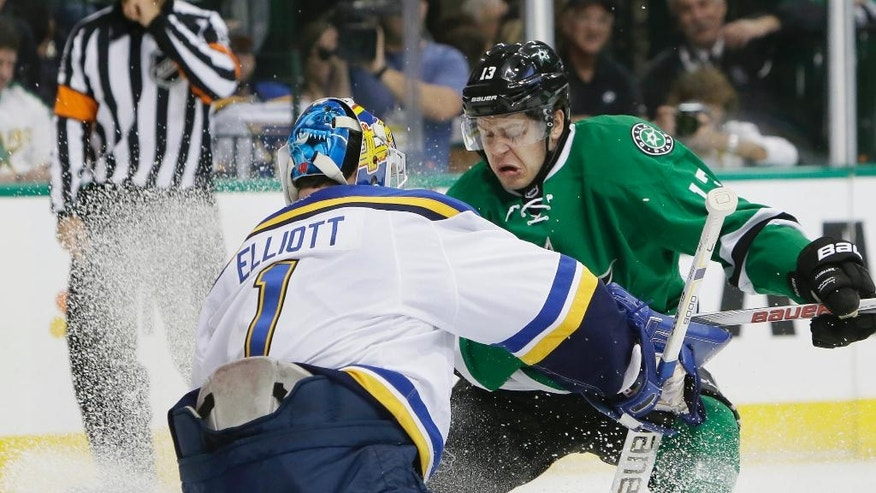 St. Louis Blues goalie Brian Elliott (1) stops a shot by Dallas Stars center Mattias Janmark (13) during the first period in Game 1 in the second round of the NHL Stanley Cup playoffs Friday, April 29, 2016, in Dallas. (AP Photo/LM Otero)