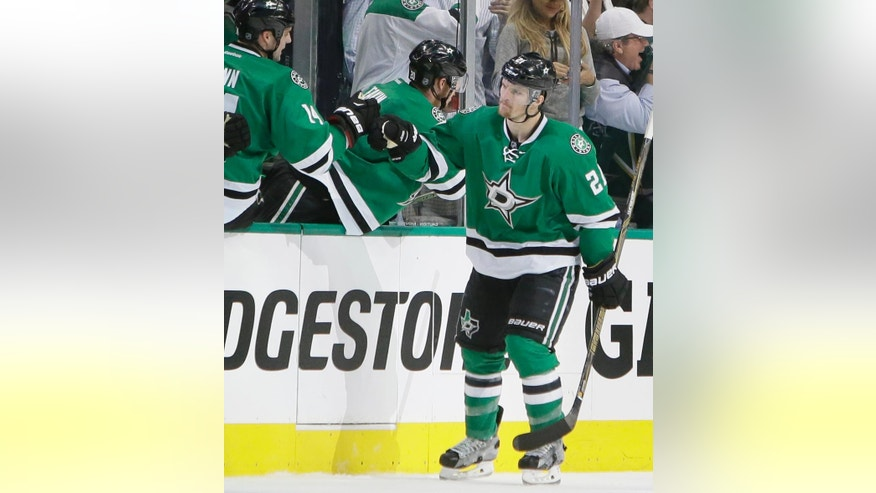 Dallas Stars left wing Antoine Roussel (21) celebrates his goal with teammate Jamie Benn (14) during the second period in Game 1 in the second round of the NHL Stanley Cup playoffs against the St. Louis Blues Friday, April 29, 2016, in Dallas. (AP Photo/LM Otero)