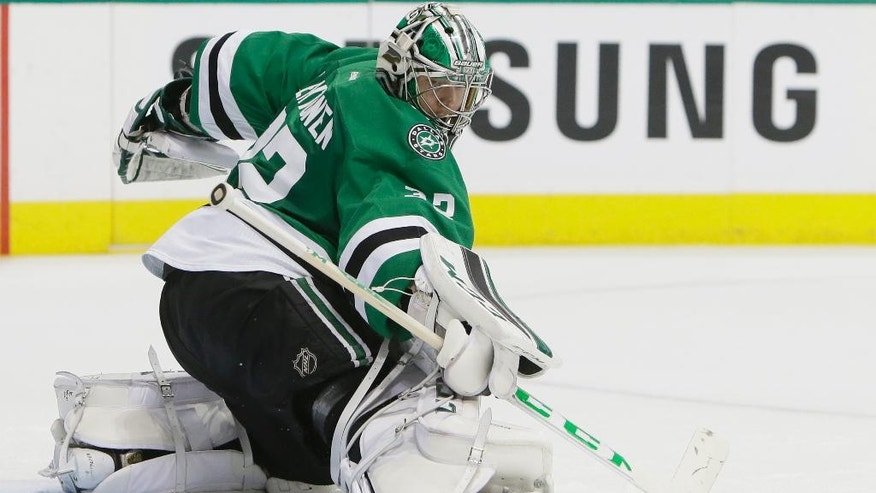 Dallas Stars goalie Kari Lehtonen (32) deflects a shot during the second period in Game 1 in the second round of the NHL Stanley Cup playoffs against the St. Louis Blues, Friday, April 29, 2016, in Dallas. (AP Photo/LM Otero)