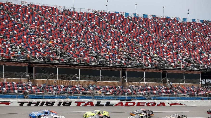 Drivers head along the track during the ARCA auto race at Talladega Superspeedway, Friday, April 29, 2016, in Talladega, Ala. (AP Photo/Brynn Anderson)