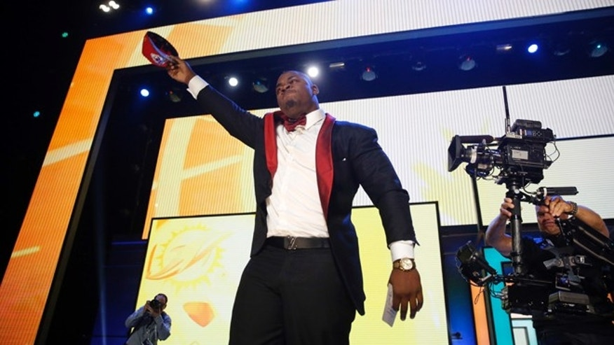 Mississippi State's Chris Jones celebrates after being selected by the Kansas City Chiefs as the 37th pick in the second round of the 2016 NFL football draft, Friday, April 29, 2016, in Chicago. (AP Photo/Charles Rex Arbogast)