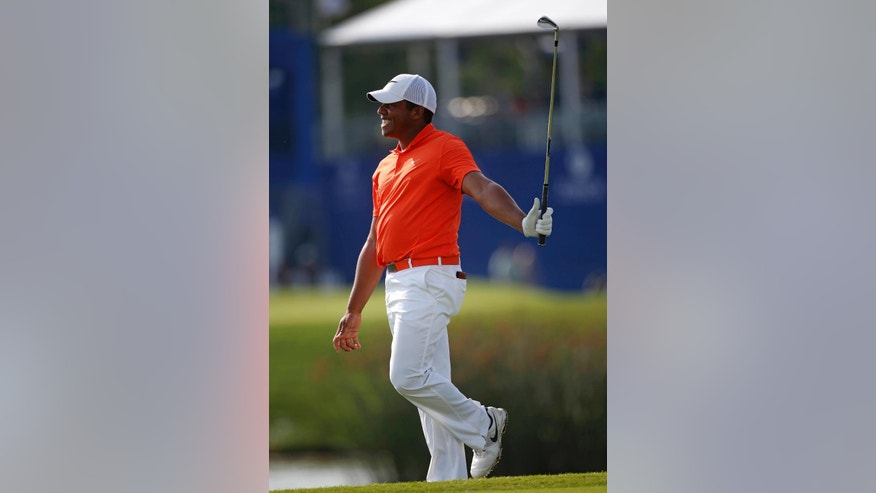 Jhonattan Vegas, of Venezuela, reacts after missing birdie on the ninth hole, his final hole for the day, during the second round of the PGA Zurich Classic golf tournament at TPC Louisiana in Avondale, La., Friday, April 29, 2016. (AP Photo/Gerald Herbert)
