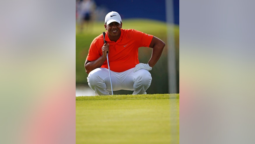 Jhonattan Vegas, of Venezuela, lines up his shot on the ninth hole, his final hole for the day, during the second round of the PGA Zurich Classic golf tournament at TPC Louisiana in Avondale, La., Friday, April 29, 2016. (AP Photo/Gerald Herbert)
